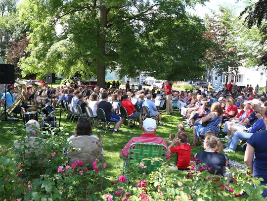 People fill the backyard of the Morgan-Manning House