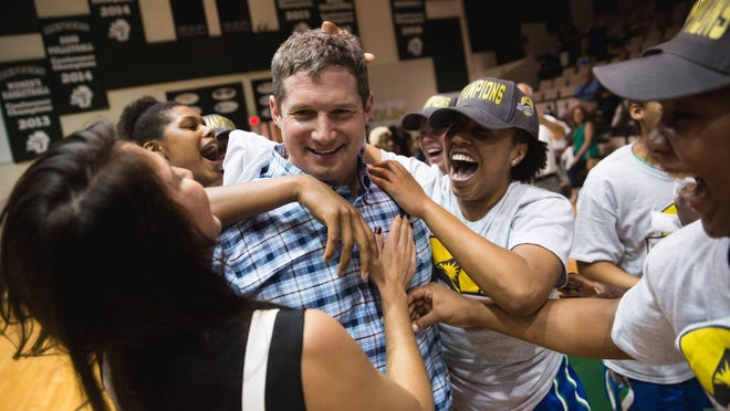 Reports say FGCU women's basketball coach Karl Smesko, seen here after his team won the Atlantic Sun Conference title last month, has been on the Southern Cal campus.