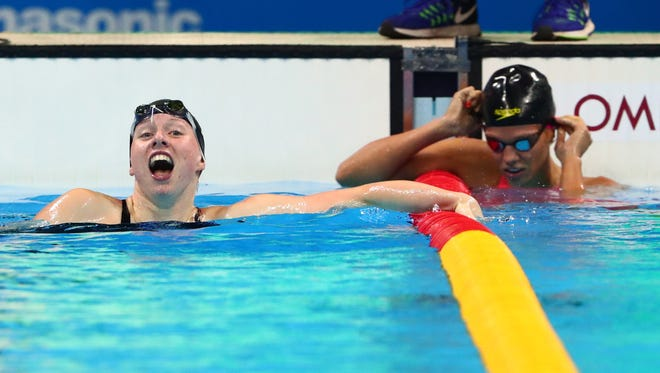 Lilly King (USA) celebrates next to Yulia Efimova (RUS) after winning the women's 100m breaststroke final during the Rio 2016 Summer Olympic Games.