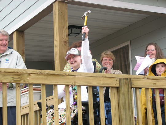 Gypsy Rose Blancharde raises her hammer during the dedication of her family's new home.