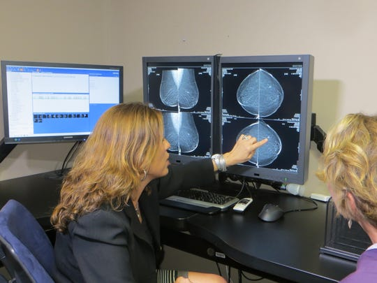 Dr. Stamatia Destounis of Elizabeth Wende Breast Care discusses a mammogram with a patient.