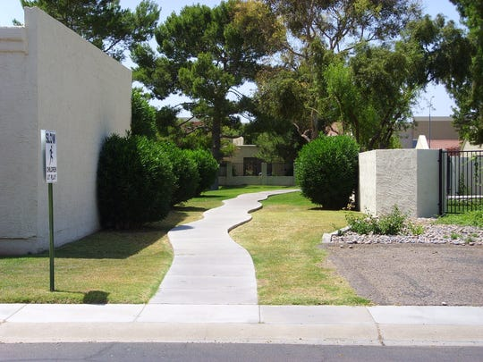 A Hacienda del Rey alley before it was xeriscaped.