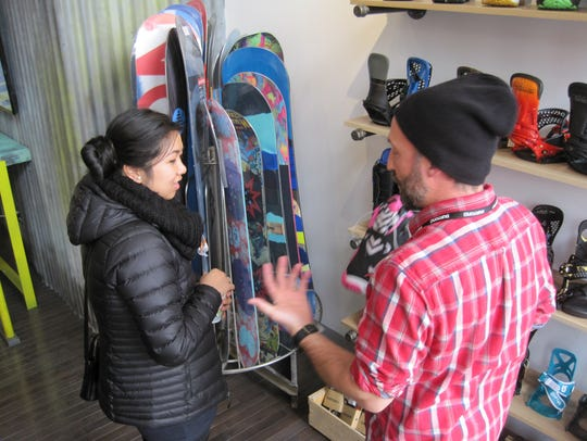 Burton store manager Drew Lucier talks to Lily Nguyen
