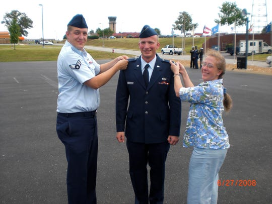 Air National Guard Captain Nathan Richeson with his