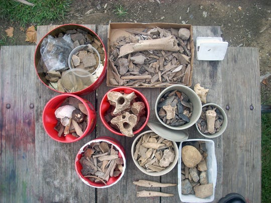 Animal bones, pottery and other artifacts were photographed here after being recovered in Jackson County. Four men were arrested after excavating and stealing the artifacts, along with Native American bones, marking the first criminal enforcement of the Native American Graves Protection and Repatriation Act in the southern district of Ohio.