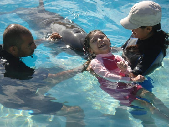 Karizma Vargas has traveled the world, including to swim with dolphins in Mexico.