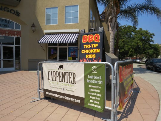 Barricades and banners surround the smoker outside J Wolf Catering, a new restaurant on Ventura Avenue in Ventura.