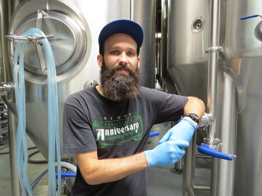 Todd Slater poses at Institution Ale Co. in Camarillo, where he is a brewer. Slater also serves as president of both the Thousand Oaked Homebrewers and the Ventura County Brewers Guild.