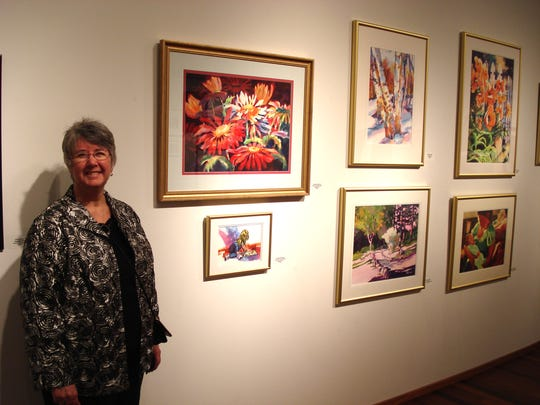 Kathy Braud is shown with her 2014 exhibit at the Morrison County Government Center. Now her work can be seen at Whitney Senior Center.