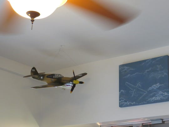 A model airplane built by Everett Kay Hansen hangs from the ceiling at Kay's Coffee Shop in Ventura's Pierpont Beach neighborhood.