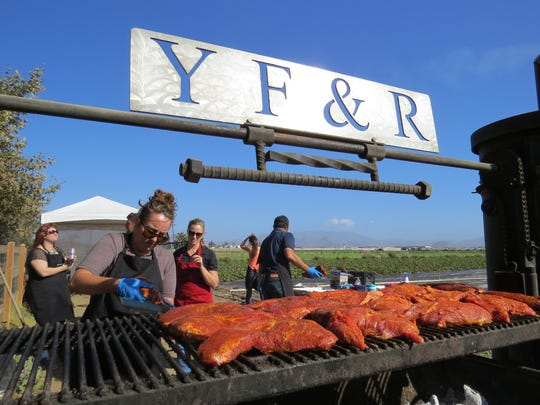 Members of Young Farmers & Ranchers prepare the post-tour barbecue on Ventura County Farm Day in 2014. This year, the ticketed meal will be served at the Ventura County Fairgrounds.