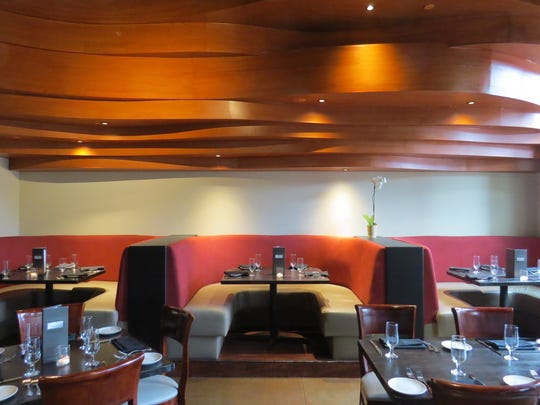 Curvaceous wood panels are part of the dining-room decor at The Gallery Restaurant in Westlake Village.
