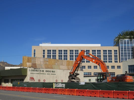 Construction equipment is seen at the East Main Street address left vacant by the demotion of the Midtown Building in Ventura. The structure was removed to help create an access road to Community Memorial Hospital, visible in the background.