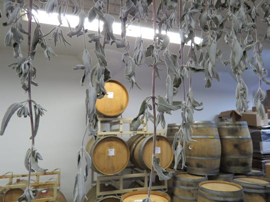 Locally foraged botanicals are hung for drying at the Ventura Spirits craft distillery in Ventura.