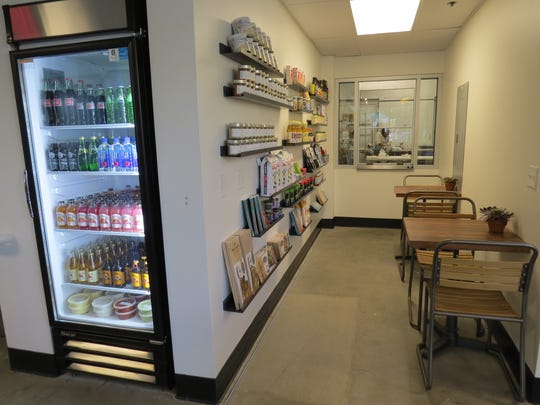 Shelves of sushi-making supplies and an observation window that looks into the processing plant are part of the scene at Kanaloa Seafood in Oxnard.