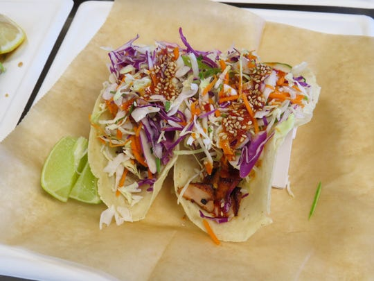 """At Kanaloa Seafood, an order of Korean tacos features kalbi-marinated salmon topped with kimchi aioli and red chili sesame salsa. The dish is one of the cafe's """"two people dine for $20"""" options during Dine & Discover Oxnard Restaurant Week from Jan. 20-29."""
