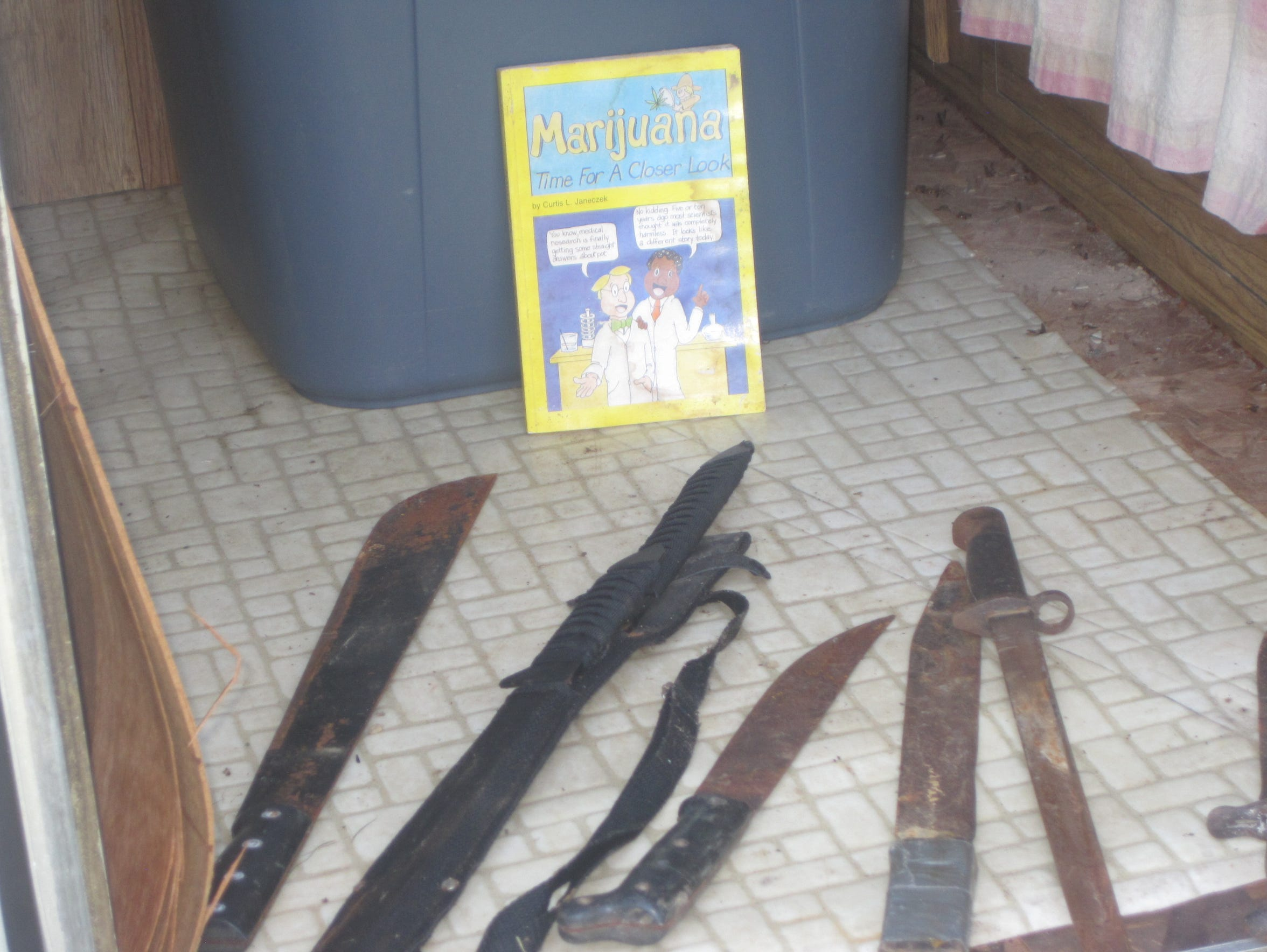 Machetes found in 2012 in Felix Vail's tornado-damaged