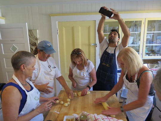 Chef Diego Felix takes a moment to snap a cellphone photo while teaching a South American Feast-themed class at the Ojai Culinary School at the Lavender Inn in 2015.