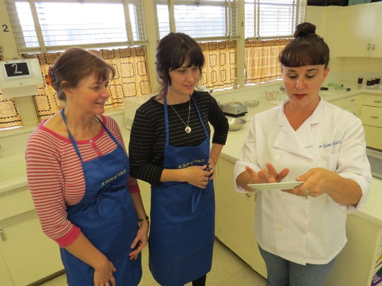Instructor Larisa Robles, right, demonstrates the cold-plate method for testing jelly set point for students Karen Dilwith and daughter-in-law Breonna Goodwin during a canning class offered by Ventura Adult and Continuing Education, or VACE, in 2015. Classes take place at Ventura High School.