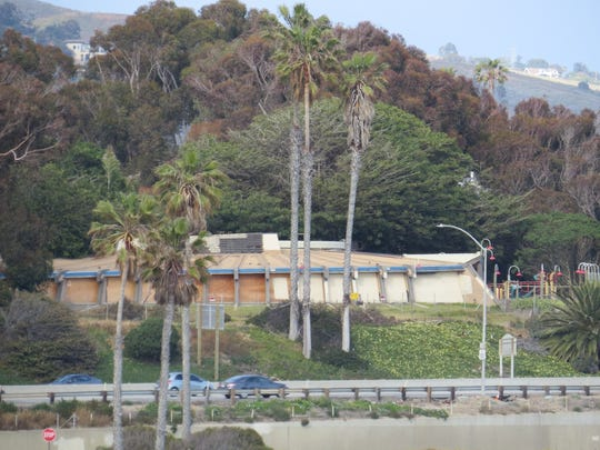 Perched on a bluff overlooking Highway 101, the former