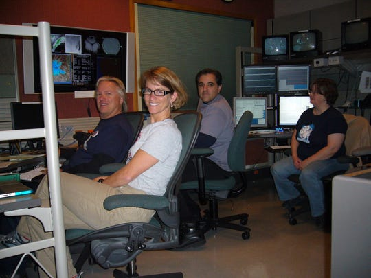 Nancy Chanover poses with her team at the Apache Team Observatory.