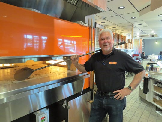 Scott Soller, operations director for H.R. Pizza Holdings LLC, wields a peel at Blaze Pizza in Oxnard, the group's newest restaurant.