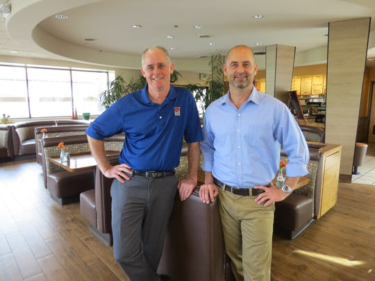 """Ken Schuberg, left, and brother Jeff Schuberg pose in the dining room of their Presto Pasta restaurant in Camarillo. Opening """"more locations equals more opportunities"""" for staff, Jeff Schuberg says of continued expansion plans for Ventura and Los Angeles counties."""