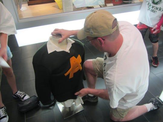 CSU athletics historian John Hirn puts a sweater worn