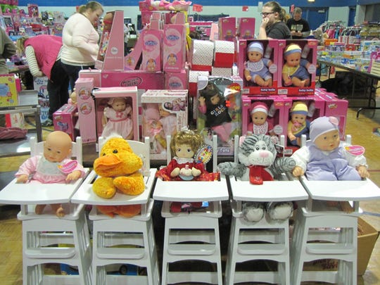 People set out and organize toys for the annual Toy