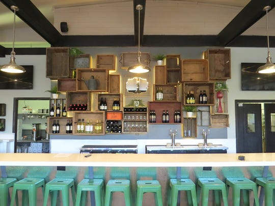 Vintage wooden crates from an antiques store in Santa Paula are repurposed as behind-the-bar shelving at The 2686 Kitchen in midtown Ventura.