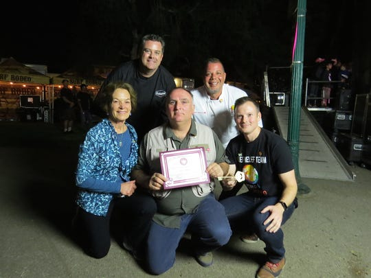 Chef Jose Andres, center, poses backstage at the Feb. 3 Thomas Fire Benefit Festival in Ventura with, from left clockwise, World Central Kitchen volunteers Susanne Lammot, chef Tim Kilcoyne and chef Jason Collis, and with friend/documentary producer Nate Mook. Andres was presented with a proclamation and a key to the city during the event, in recognition of his help in feeding first responders and others affected by the Thomas Fire.