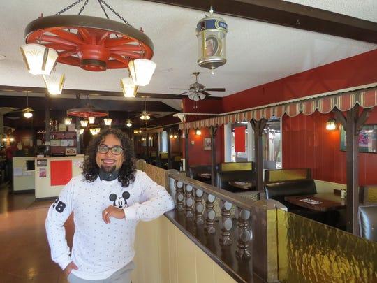 """Joseph """"Jo Jo"""" Morales Ramirez poses in the dining"""
