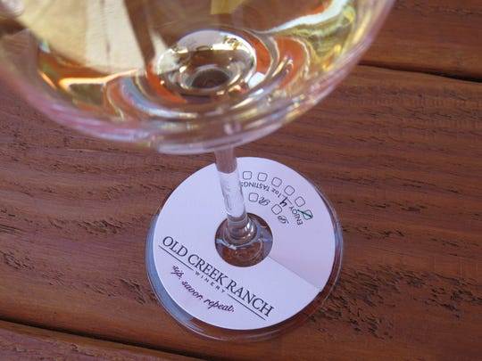 A paper tag helps track pours during a wine-tasting event at Old Creek Ranch Winery. The site will reopen to the public on April 7 following nearly three years of renovations by its new owners.