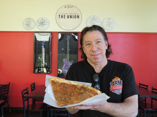 Mick-with-pizza-slice-guitar-wall.JPG