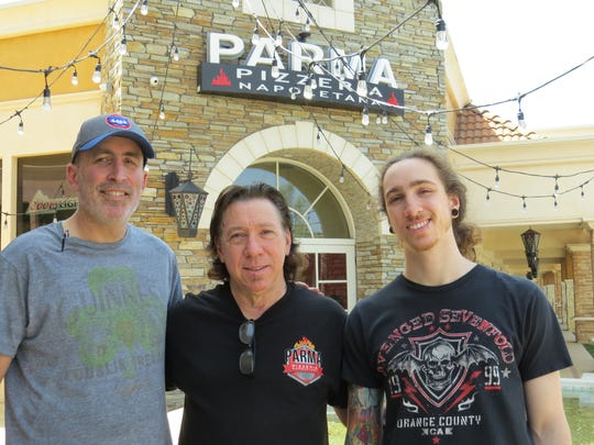 Mick Mahan and son Michael Mahan, right, pose in front of Parma Pizzeria Napoletana in Thousand Oaks with Phil Adler, who oversees the Parma Pizza Mobile Oven side of the business.