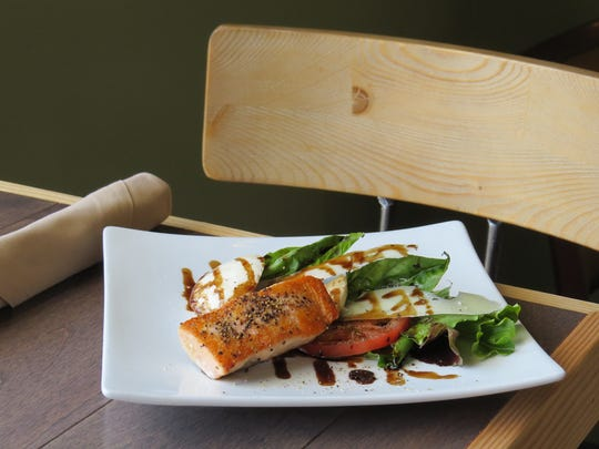 The happy hour menu at The Mad Rose in downtown Ventura includes Caprese salad with grilled salmon for $7.95.