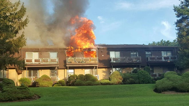 Flames rip through the upper floor of a condominium unit at Germonds Village in Bardonia on Tuesday, Aug. 16, 2016.