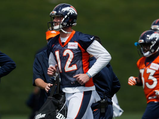 Denver Broncos quarterback Paxton Lynch runs during a drill at NFL football organized team activities at the team's headquarters Tuesday, May 23, 2017, in Englewood, Colo. (AP Photo/David Zalubowski)
