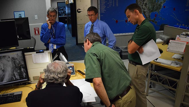 Forecasters at the National Hurricane Center discuss Tropical Storm Hermine in August 2016.
