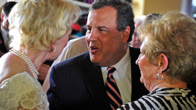 New Jersey Gov. Chris Christie greets Republican supporters at Puckett's Grocery and Restaurant in Nashville on Friday, May 30, 2014.