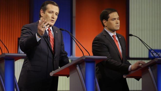 Ted Cruz speaks as Marco Rubio listens during the Republican primary debate on Jan. 28, 2016, in Des Moines.