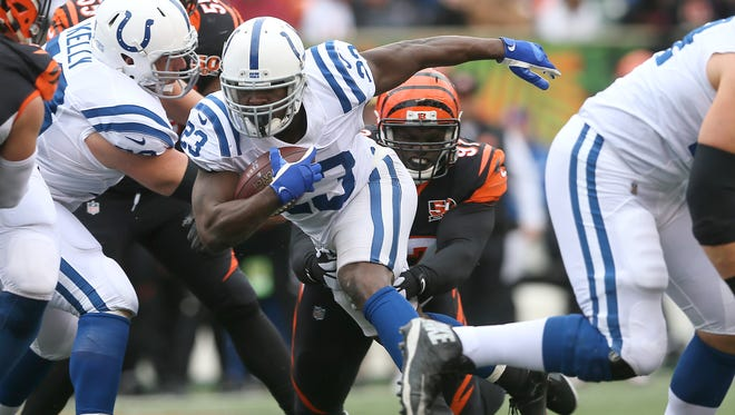 Cincinnati Bengals defensive tackle Geno Atkins (97) tackles Indianapolis Colts running back Frank Gore (23) in the second quarter during the Week 8 NFL game between the Indianapolis Colts and Cincinnati Bengals, Sunday, Oct. 29, 2017, at Paul Brown Stadium in Cincinnati.