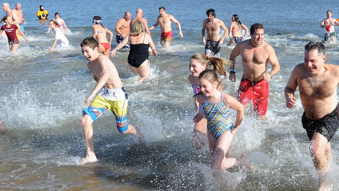 The 3rd Annual Dewey Dunk was held on New Years Day at Dagsworthy Street and the Beach in Dewey Beach, with over 100 people plunging to welcome in 2015.
