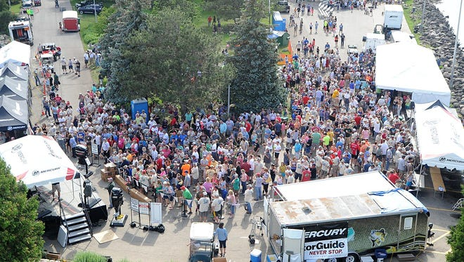 Fisherman and spectators gather at Lakeside Park for Walleye Weekend in 2015. The contest to design the official t-shirt of the festival has begun.