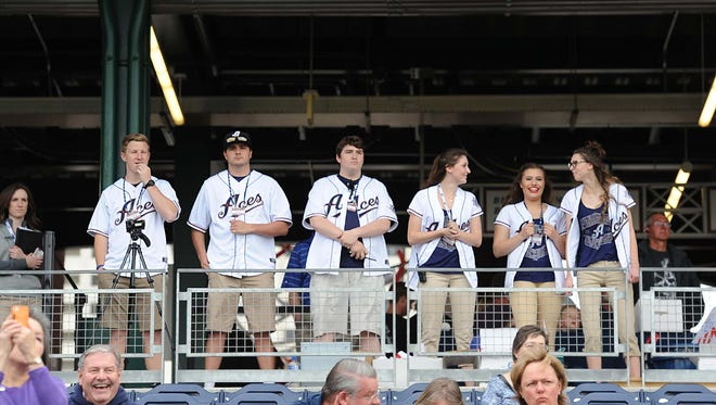 Reno Aces fans wear team gear during opening day at Greater Nevada Field on April  7.