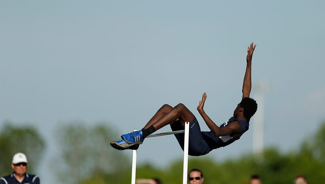 Bay Port's Cordell Tinch soars over the bar while competing in the high jump during Thursday's WIAA Div.1 sectional track and field meet at Bay Port High School in Suamico.