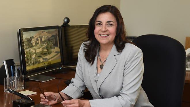 TMCC president Karin Hilgersom sit at her desk on June 23, 2016.
