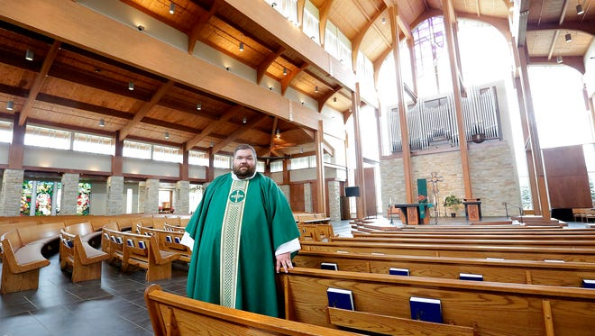 Father Ryan Pruess of Holy Family Church in Fond du Lac supports the LGBT community through the church's All God's Family program.