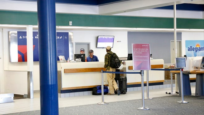 A traveler checks in Wednesday at the Delta booth inside the Elmira Corning Regional Airport. Under the renovation plans, the layout of the airport's check-in area will remain similar but will be updated.