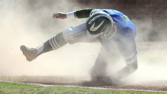 Montwood's Miguel Soto tumbles across home plate for a score against Americas Friday.